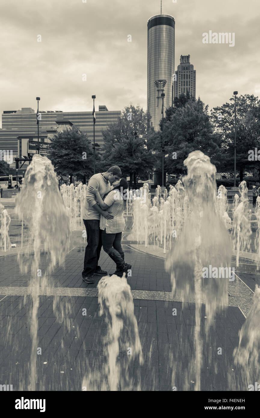 Georgia, Atlanta, Centennial Olympic Park, couple among dancing fountains - Stock Image