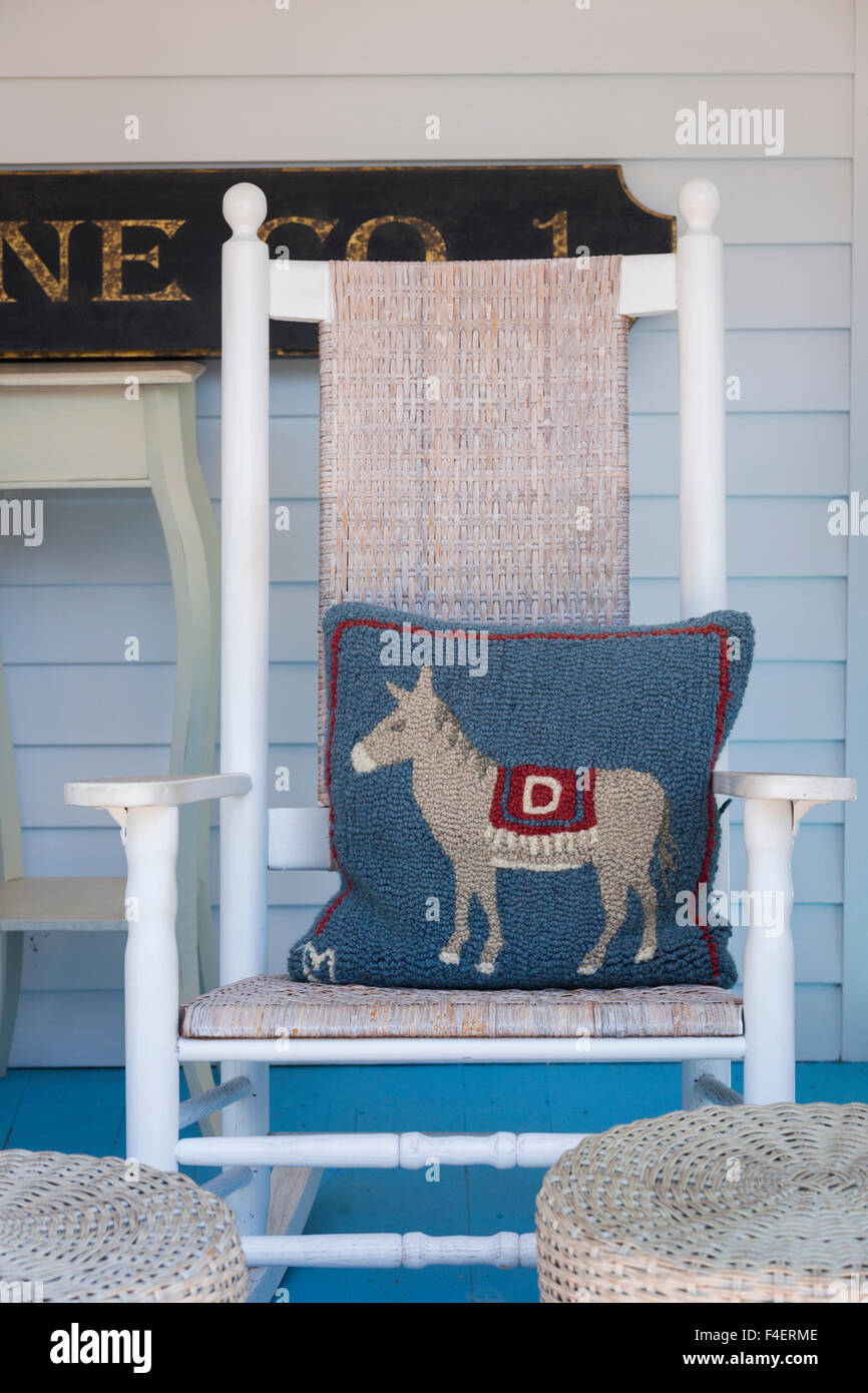 Massachusetts, Cape Cod, Provincetown, The West End, rocking chair with a donkey pillow, symbol of the US Democratic - Stock Image