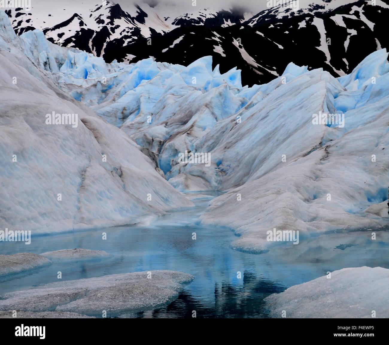 Crystal blue water on the Mendenhall glacier trek, Alaska - Stock Image