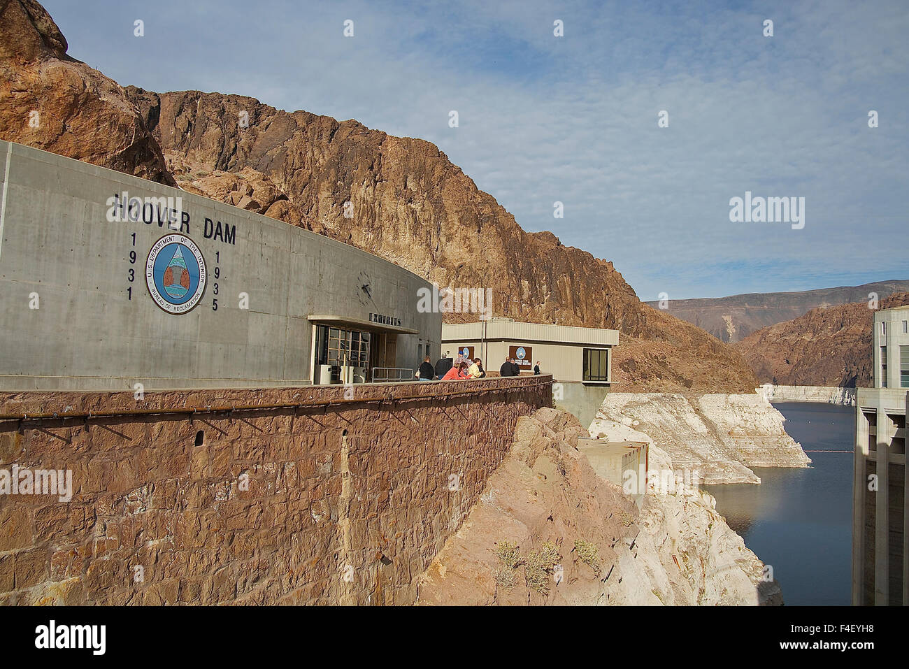 Visitors outside an exhibit hall at the Hoover Dam view the man-made and natural beauty. Nevada, United States, - Stock Image
