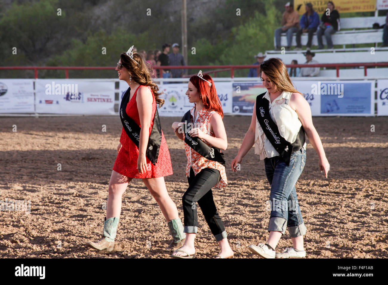 The rodeo princesses walk out to begin the rodeo, Truth or Consequences, New Mexico, USA. - Stock Image