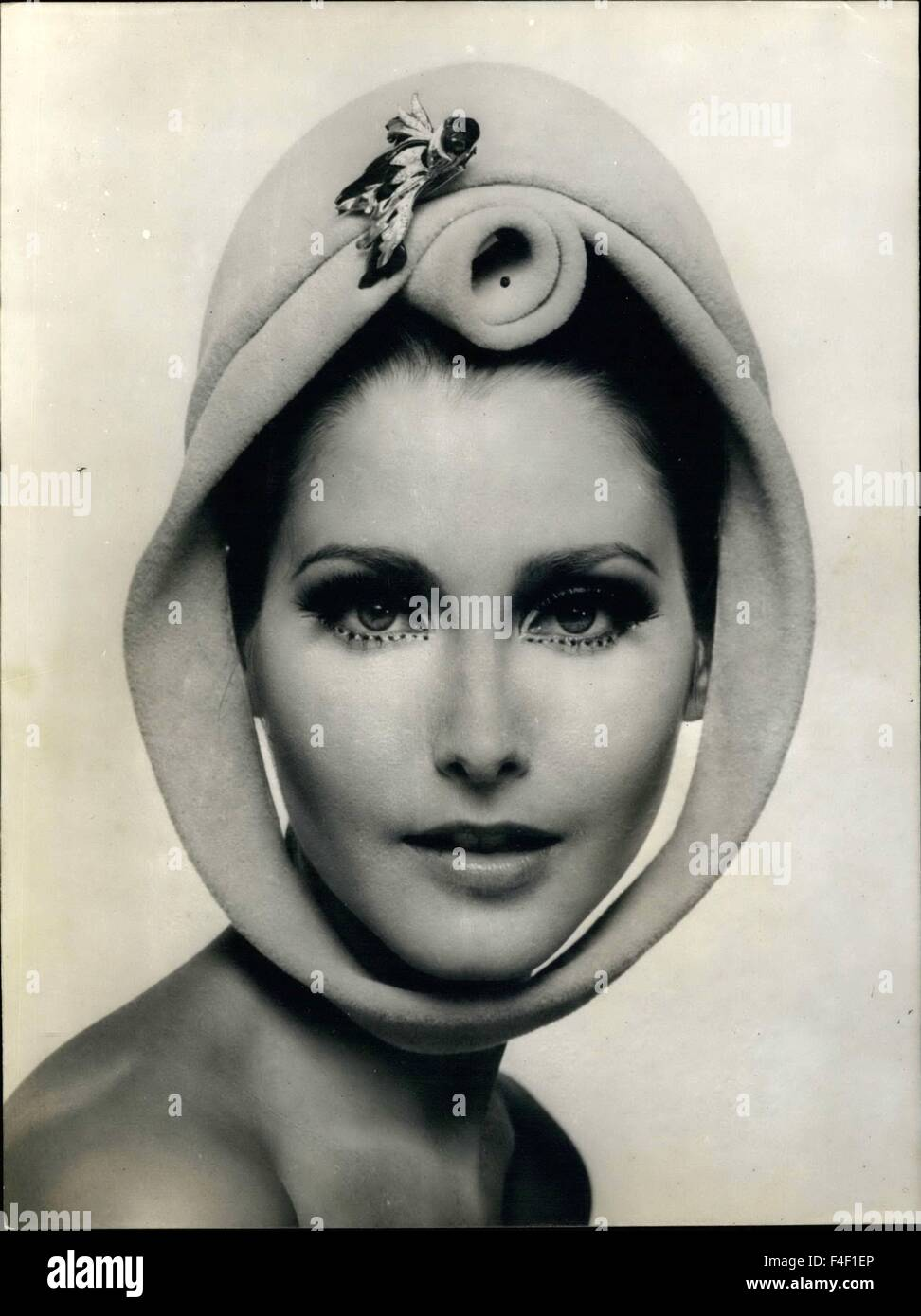 1966 - Hats Fashion Fall and Winter 1966-1967. OPS: Original hat of Marie-Christiane, with a twirled felt rose over - Stock Image