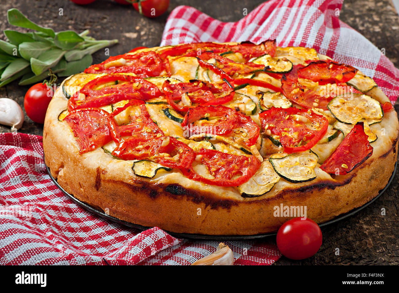 Focaccia with tomatoes and garlic - Stock Image