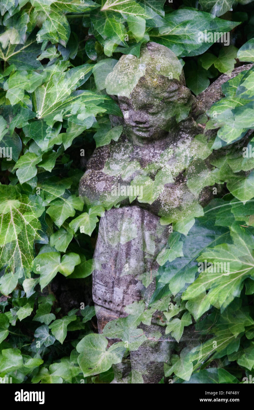 USA, Oregon, Portland. Garden angel statue montage. Credit as: Marie Bush / Jaynes Gallery / DanitaDelimont.com - Stock Image