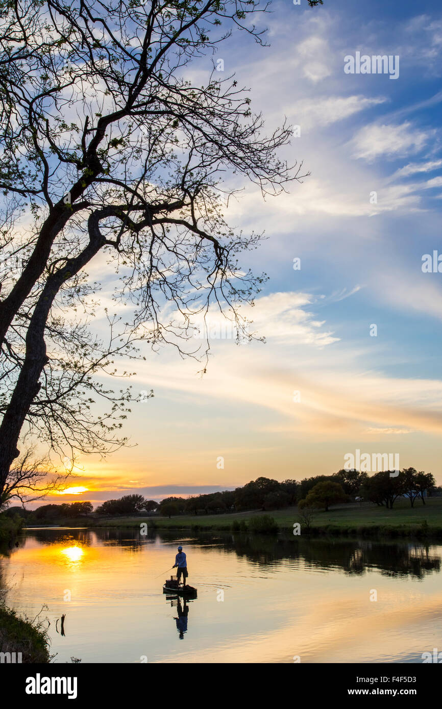 Fishing at sunset on the Pedernales River in LBJ State Park in Stonewall, Texas, USA. Stock Photo
