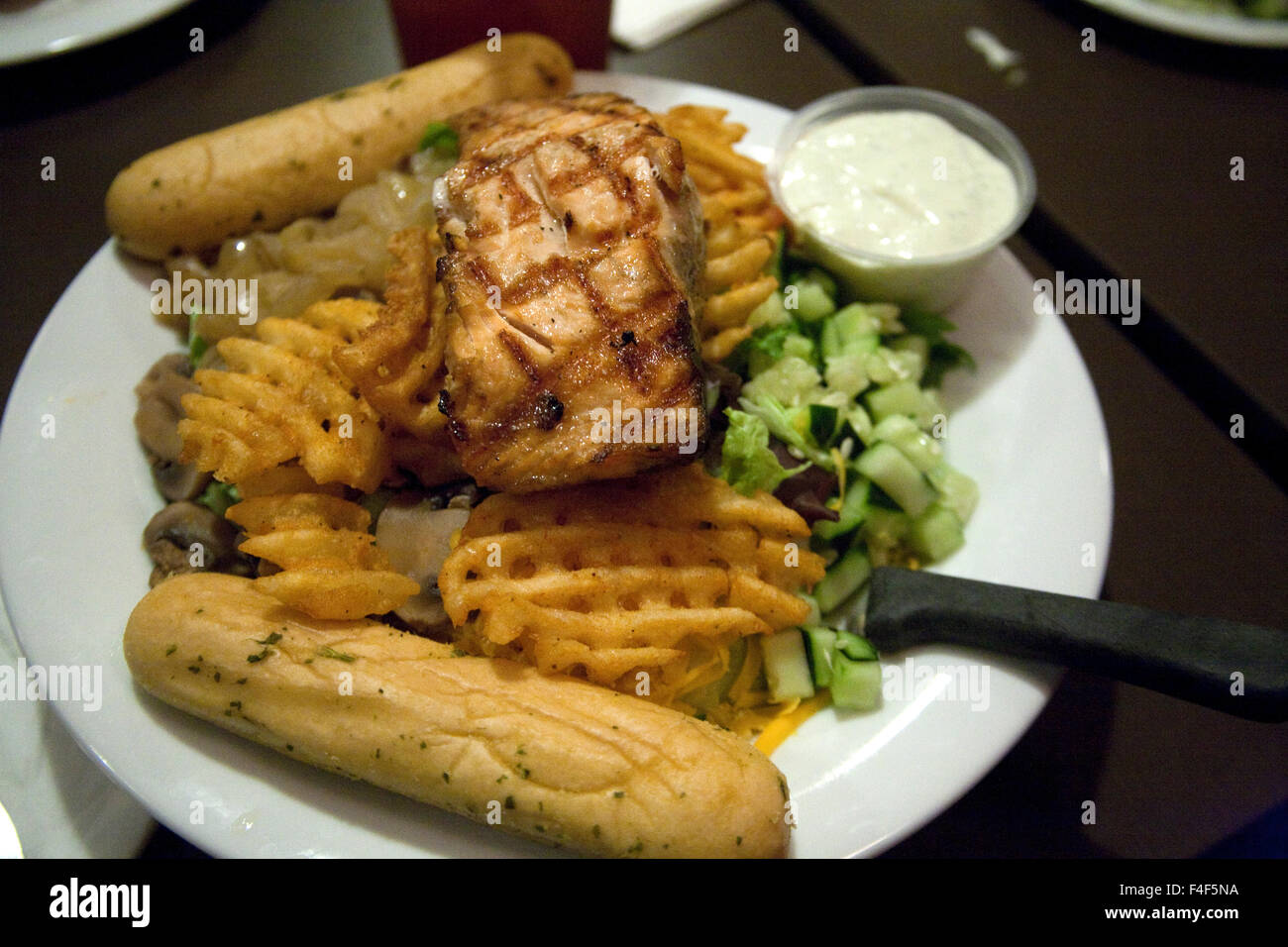 Popular Grilled Salmon Menu Selection With Pitt Style French Fries