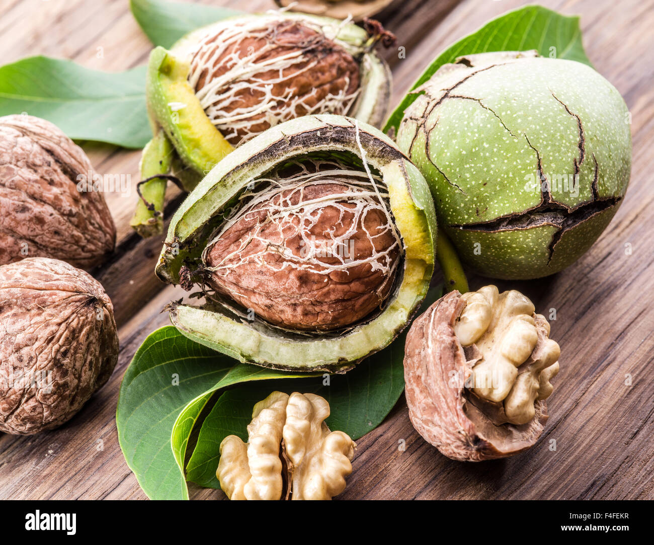 Walnut and walnut kernel on the wooden table. - Stock Image
