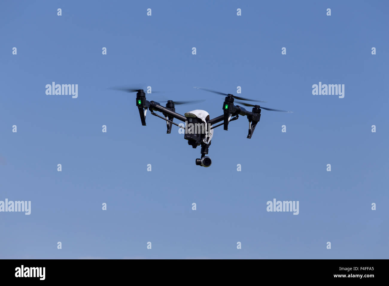 Quadcopter Drone DJI Inspire with camera for aerial photography and videos. Stock Photo