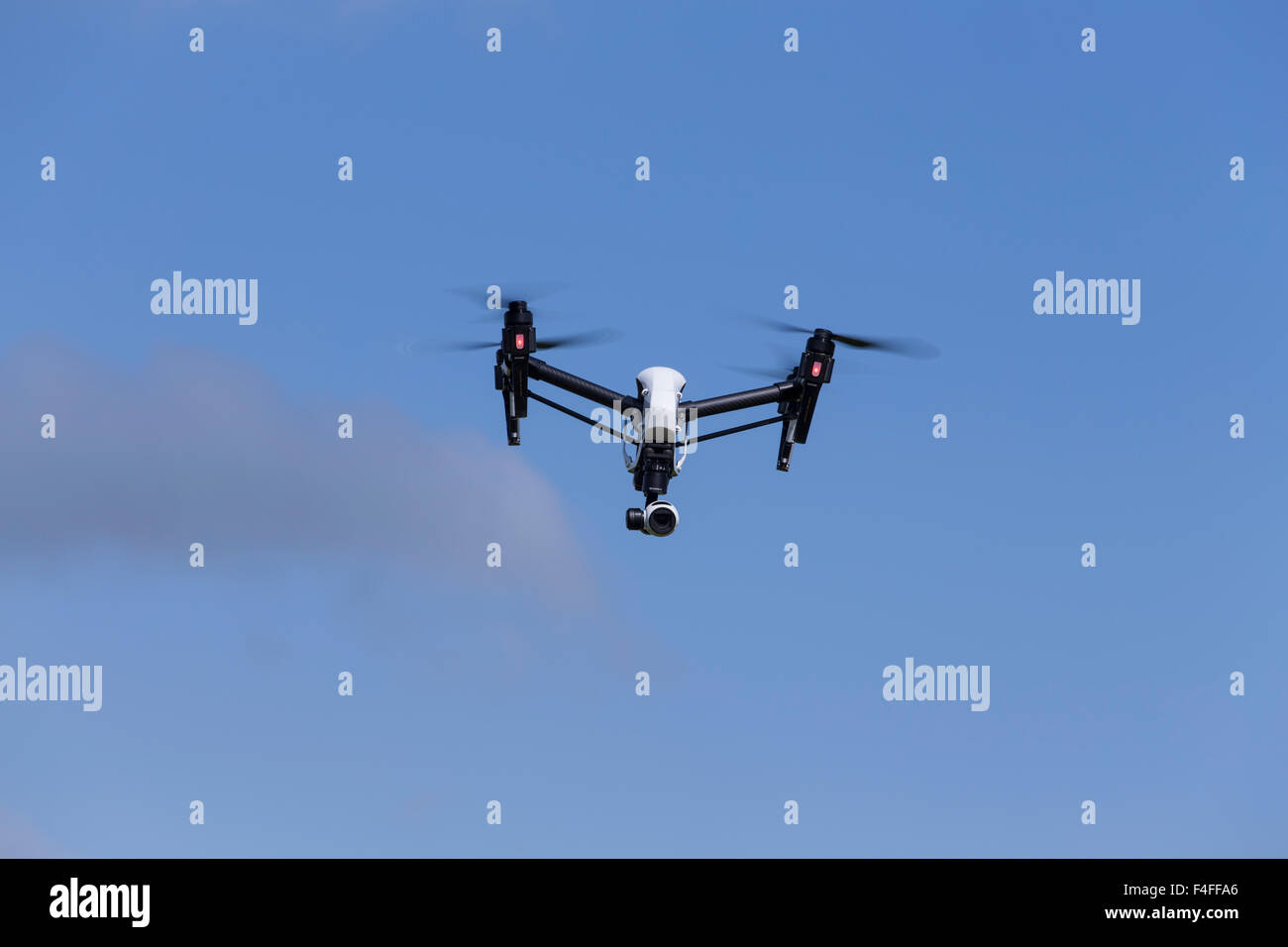 Aerial photography and videos can be taken with a .Quadcopter Drone such as a DJI Inspire - Stock Image
