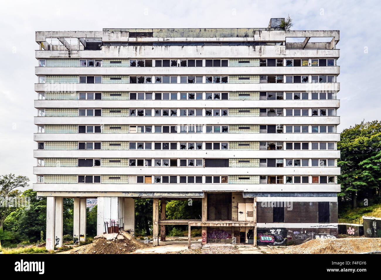 Abandoned, derelict highrise apartment residential tower block building MDU - Stock Image