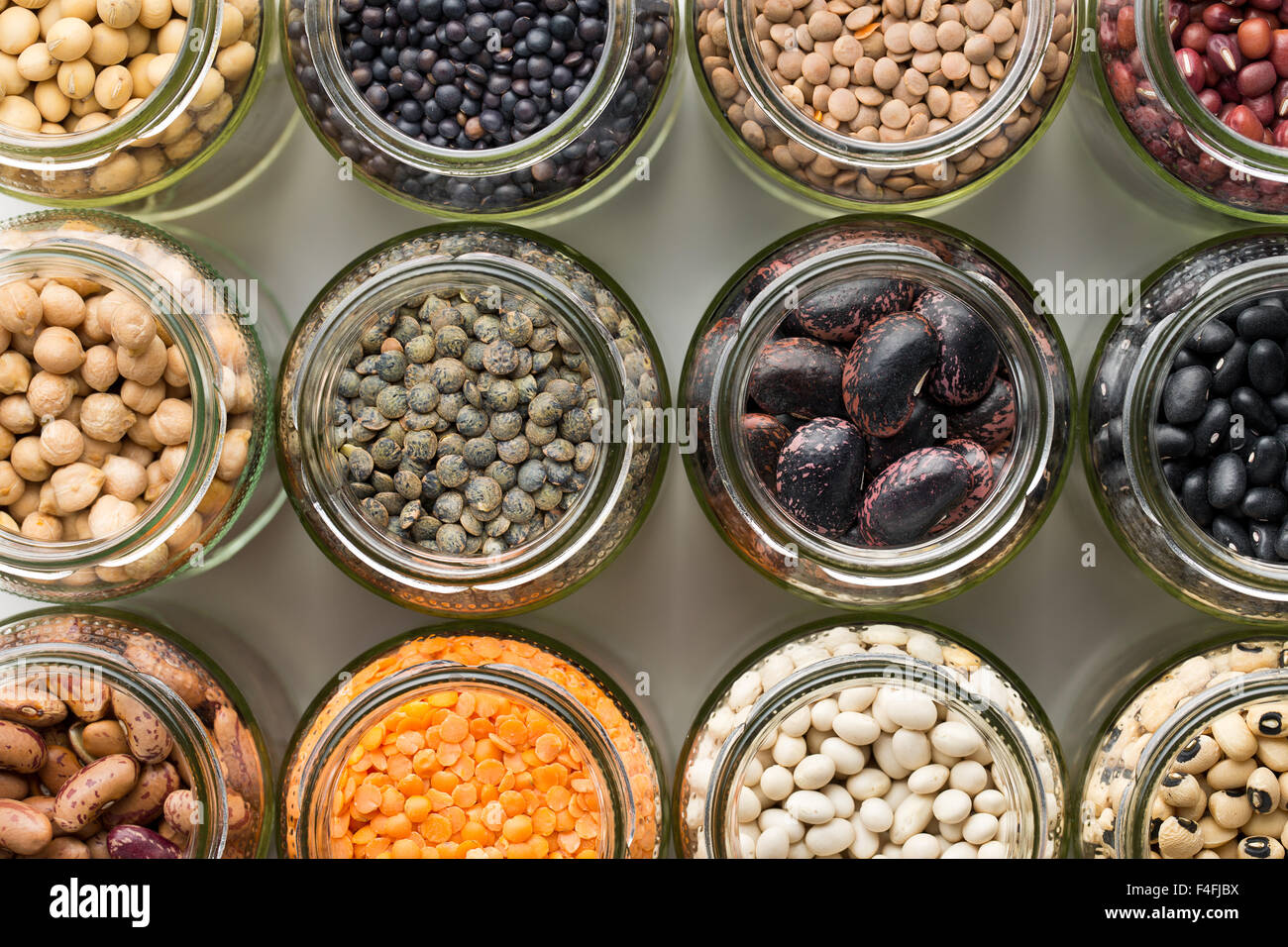 top view of various dried legumes in jars - Stock Image