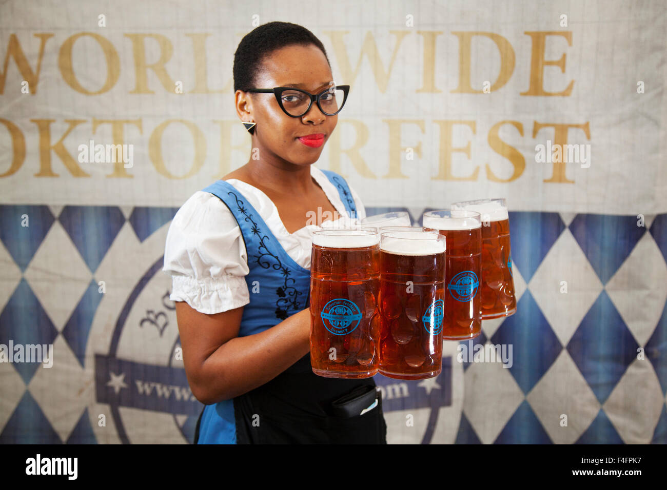 Liverpool, Merseyside, UK 17 Oct 2015. Ify from Birmingham serving beers at the Oktober Beer Festival at Exchange - Stock Image