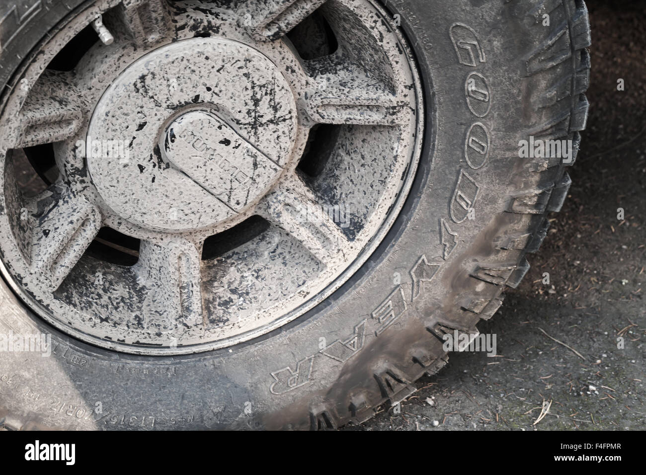 Saint-Petersburg, Russia - October 11, 2015: Dirty wheel with logotypes, Hummer H2 car fragment - Stock Image