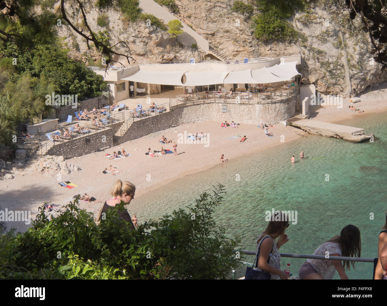 A small cove with pebble beach and steep cliffs, Dalmatian coast at its most picturesque, Bellevue Dubrovnik Croatia - Stock Image