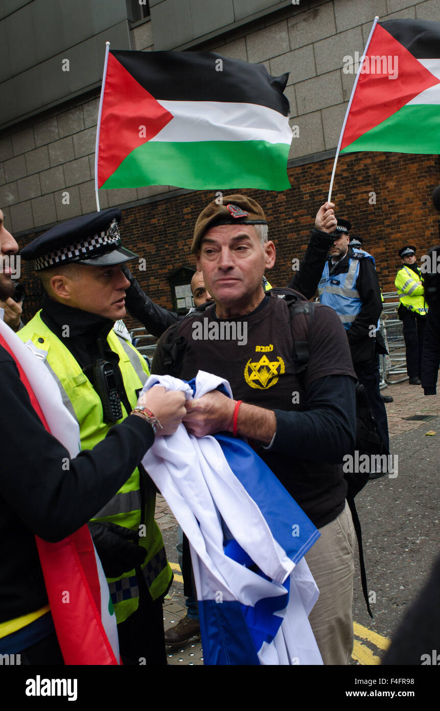 A single Israeli protester interrupts the 'Free Palestine' protest, by brandishing an Israeli flag. - Stock Image