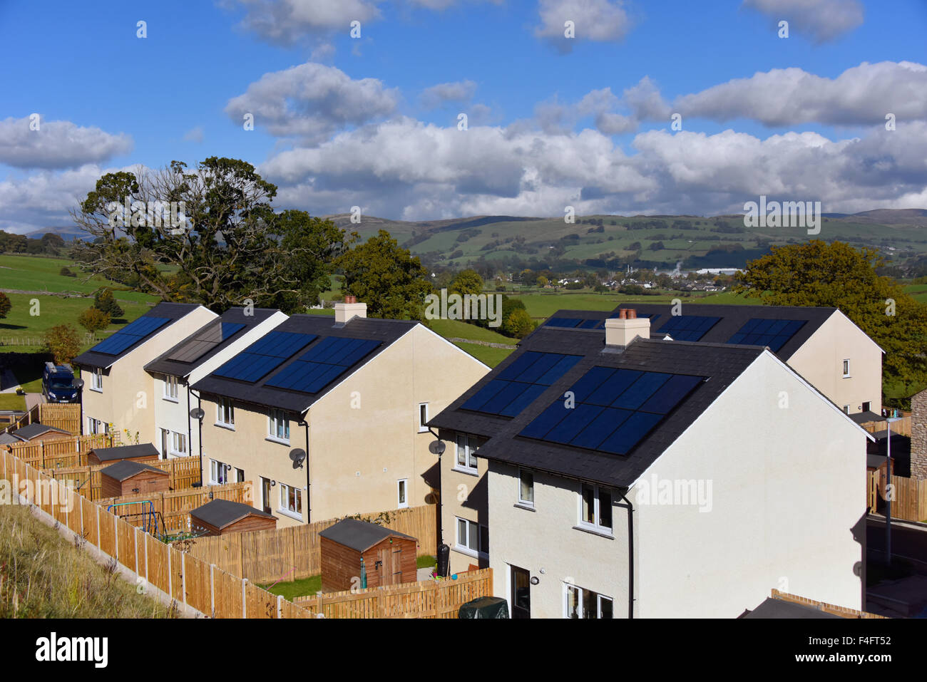 New affordable domestic housing with solar panels on roof. Fir Tree Rise, Kendal, Cumbria, England, United KIngdom, - Stock Image
