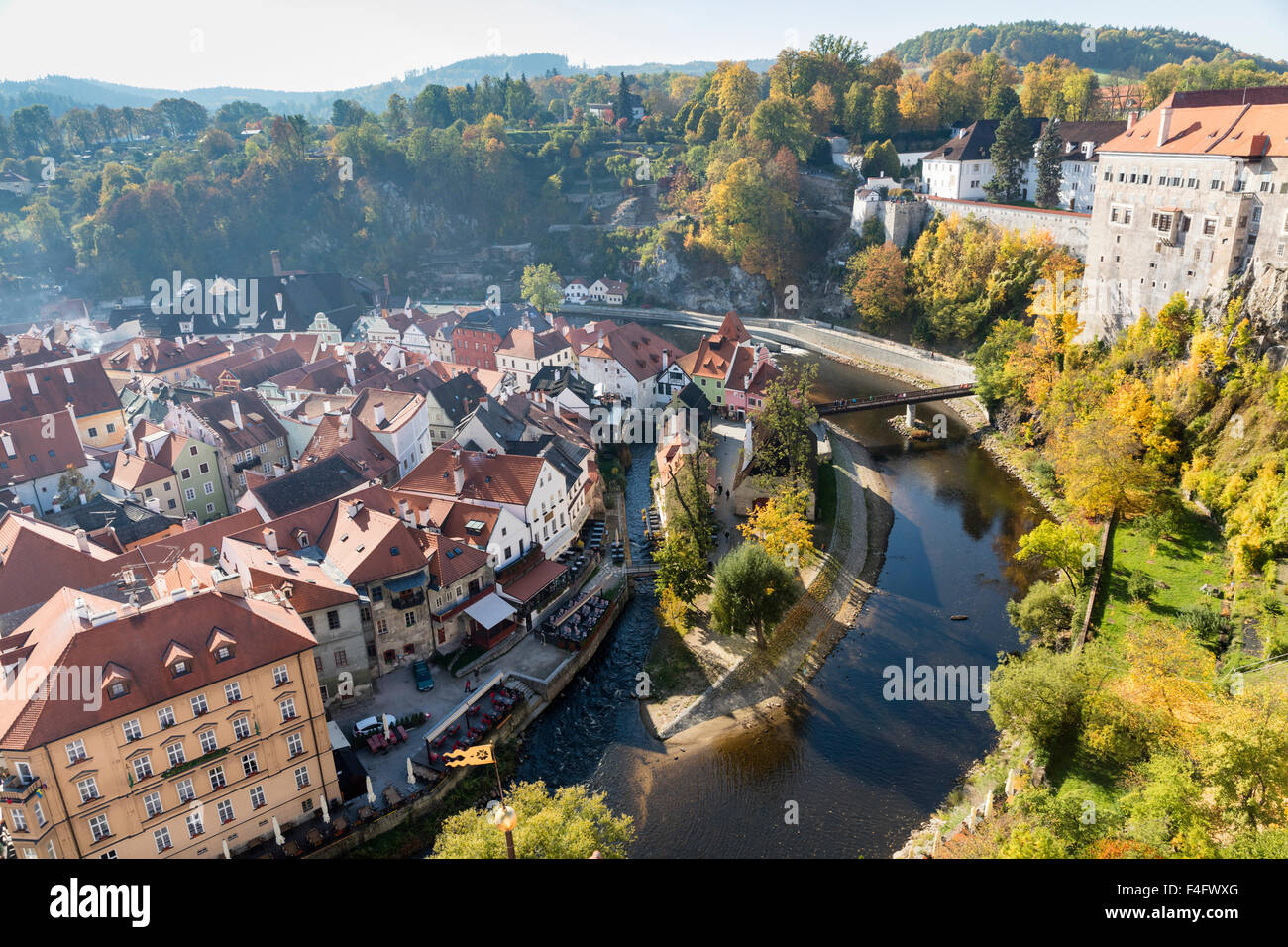 October view from Castle of Cesky Krumlov South Bohemia, Czech Republic, including castle, fall foliage, and Vltava - Stock Image