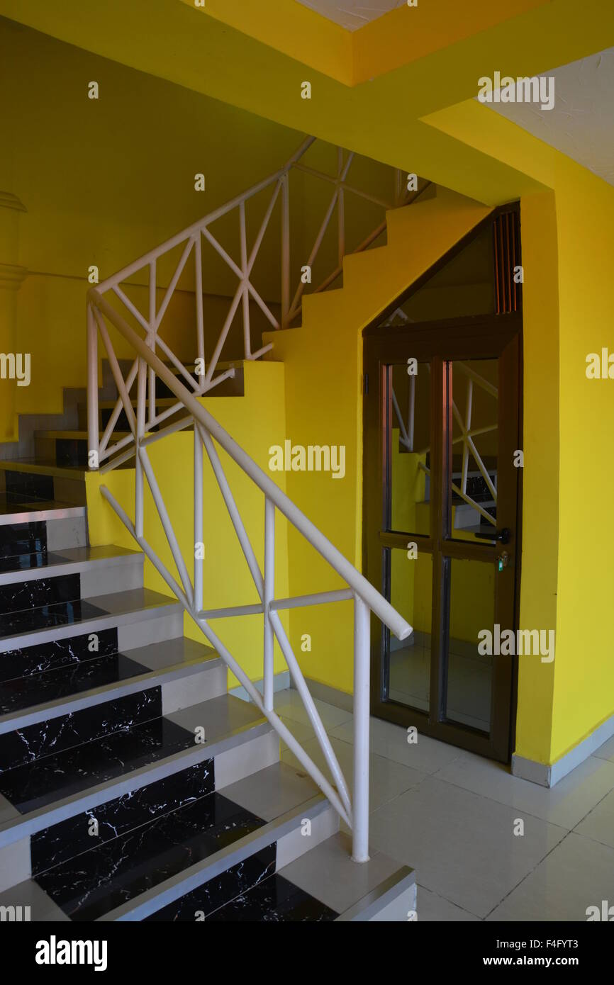 Yellow school indoor staircse - Stock Image