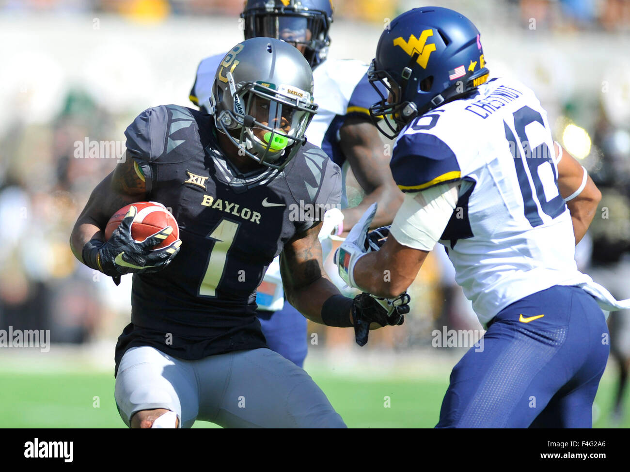 October 17, 2015: Baylor receiver Corey Coleman (1) looks to avoid West Virginia cornerback Terrell Chestnut (16) Stock Photo