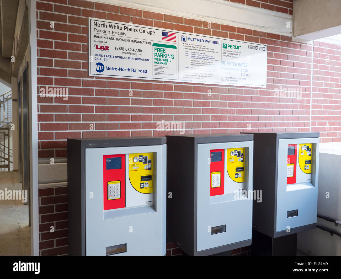 Multi-space pay stations inside the Metro-North North White Plains Station Parking Garage. - Stock Image