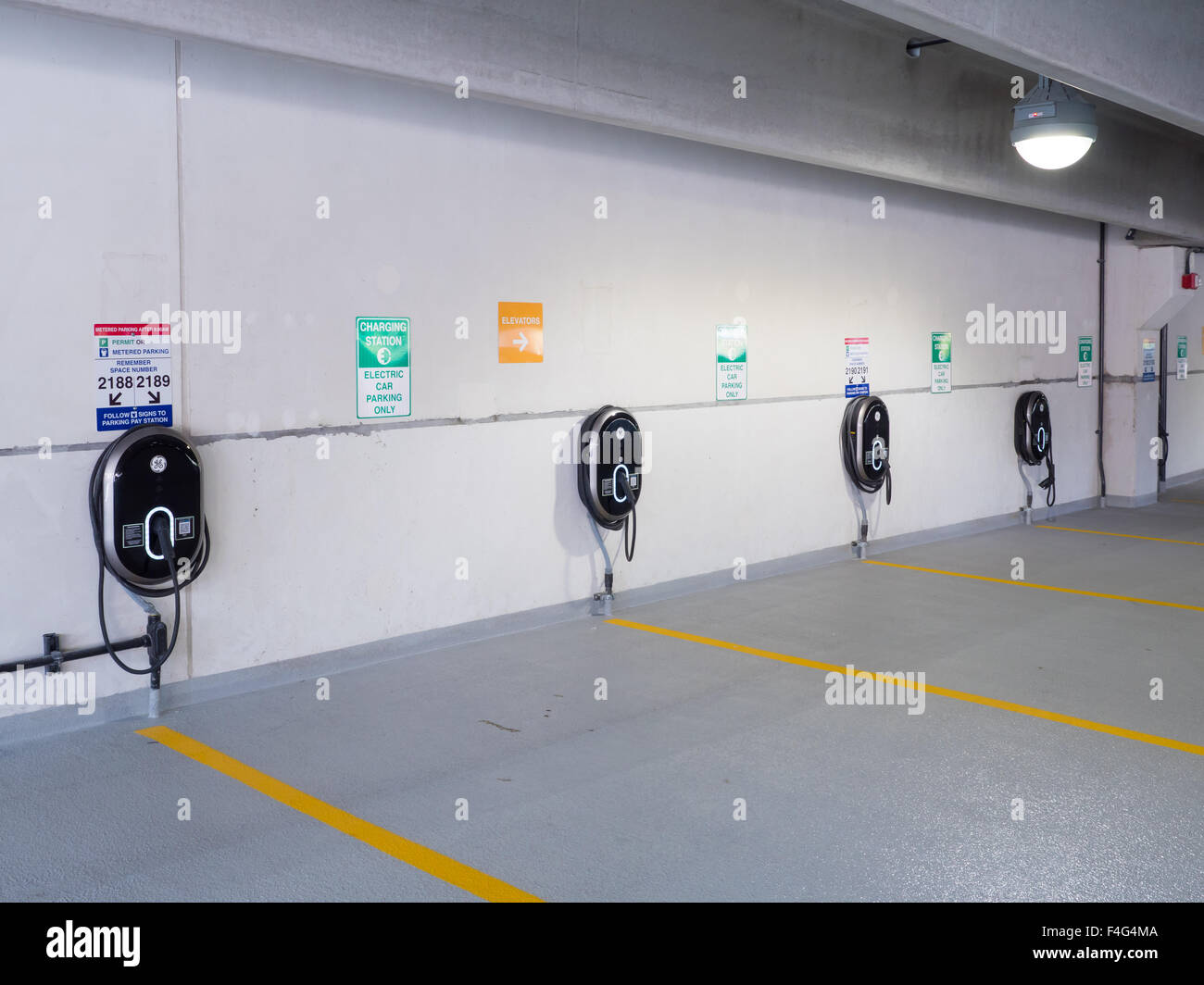 GE Wattstation electric vehicle charging stations in the North White Plains Station Parking Garage, in White Plains, - Stock Image