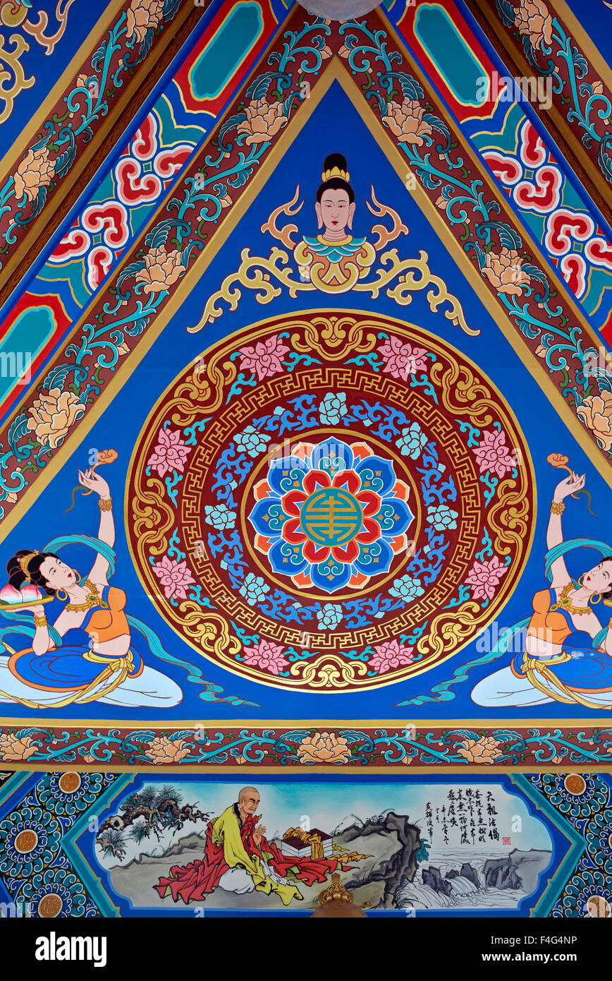 Chinese paintings and ceiling art at Wihan Sian temple Pattaya Thailand S. E. Asia - Stock Image