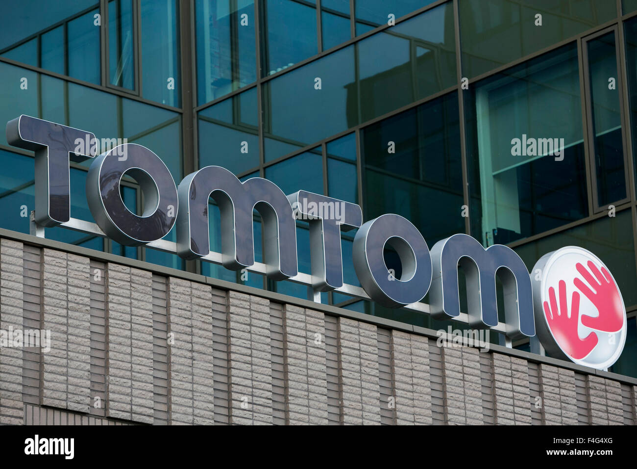 A logo sign outside of the headquarters of TomTom NV in Amsterdam, Netherlands on October 3, 2015. - Stock Image