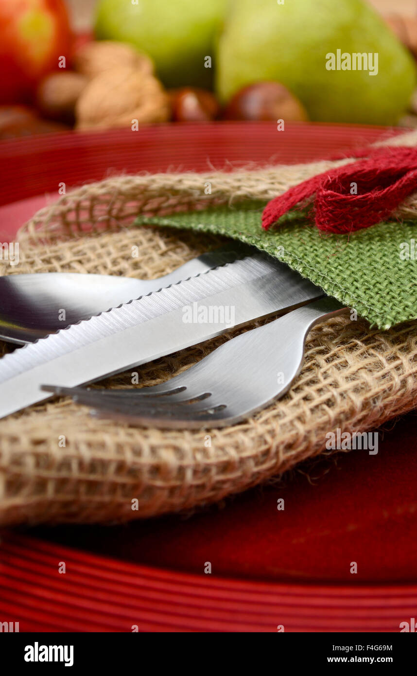 Country style rustic Thanksgiving table setting closeup on burlap ...