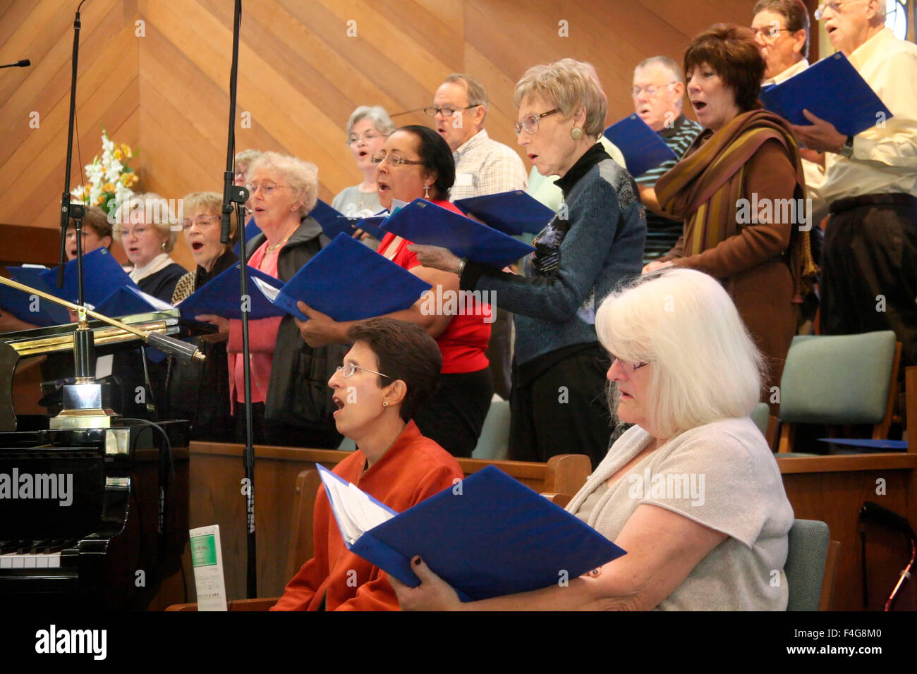 Church choir seated and standing perform at a Northern California church. (MR) - Stock Image