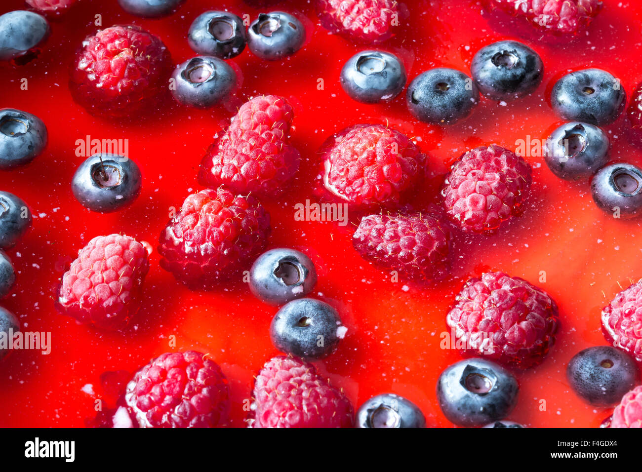 Cheesecake with the fresh raspberries and blueberries - Stock Image