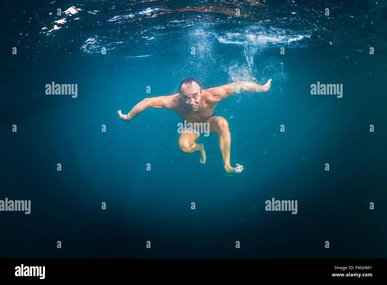 A swimming out at sea. Baignade en haute mer. - Stock Image