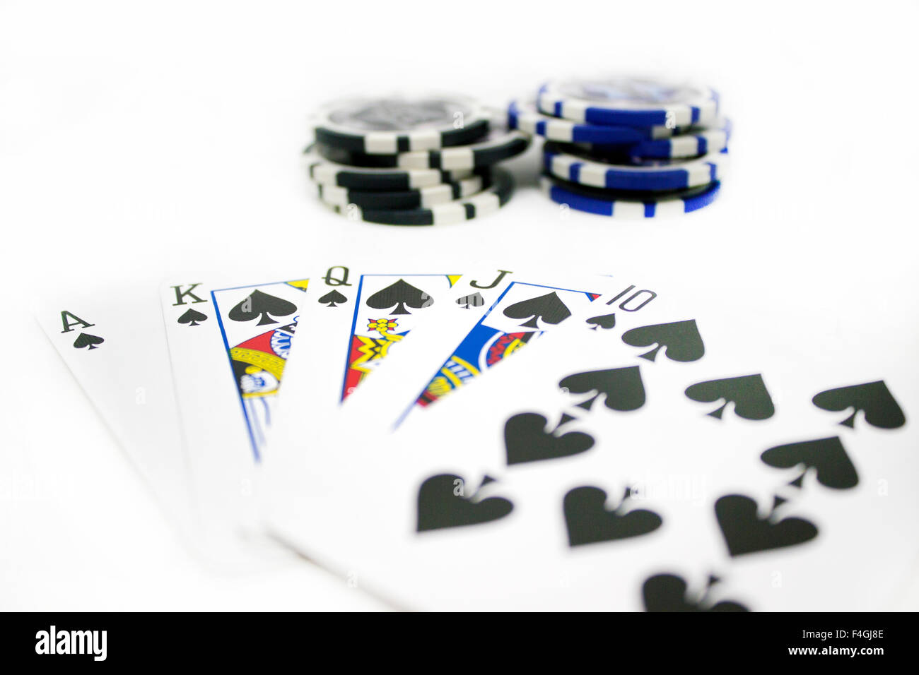 Casino gambling chips stacked and isolated on white background. - Stock Image