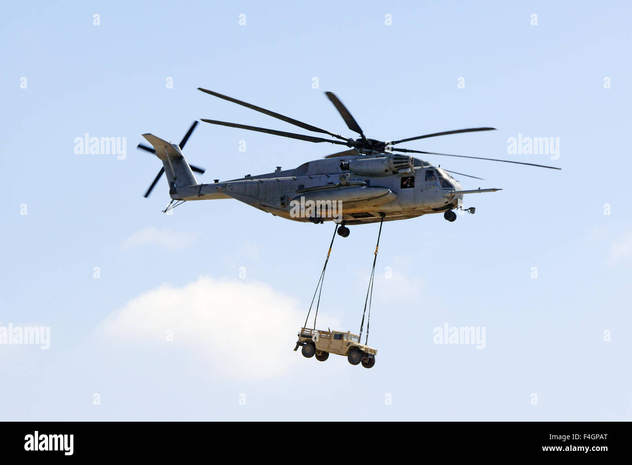 Helicopter CH-53 Super Stallion lifting a hummer vehicle at 2015 Air Show - Stock Image