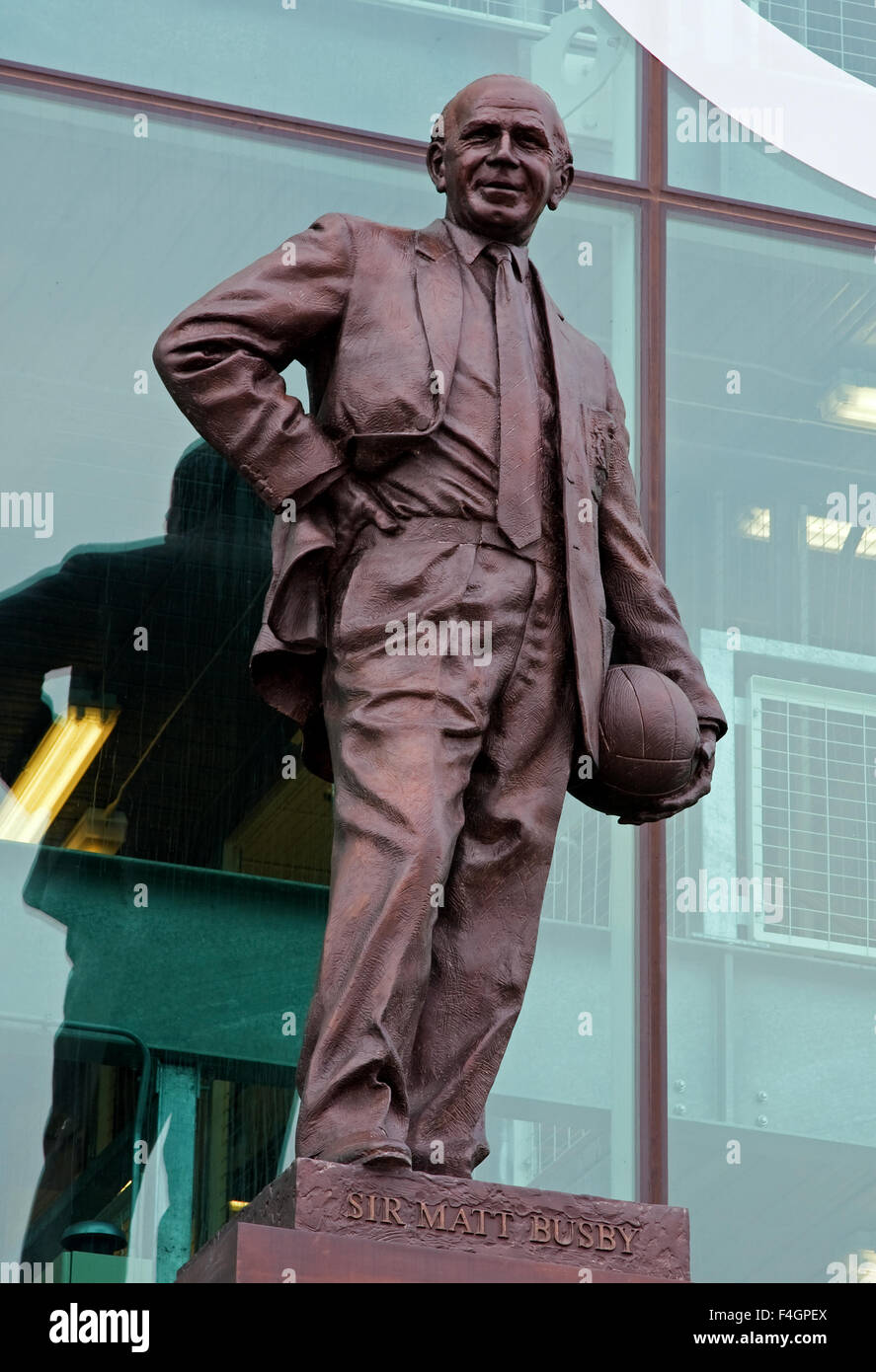 A statue of Sir Matt Busby outside Old Trafford in England celebrating his contribution to Manchester United Football - Stock Image