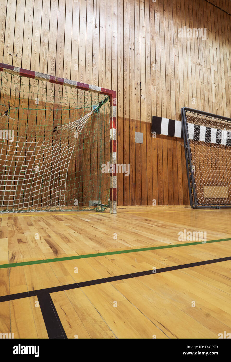 Soccer goalpost in old gymhall - Stock Image