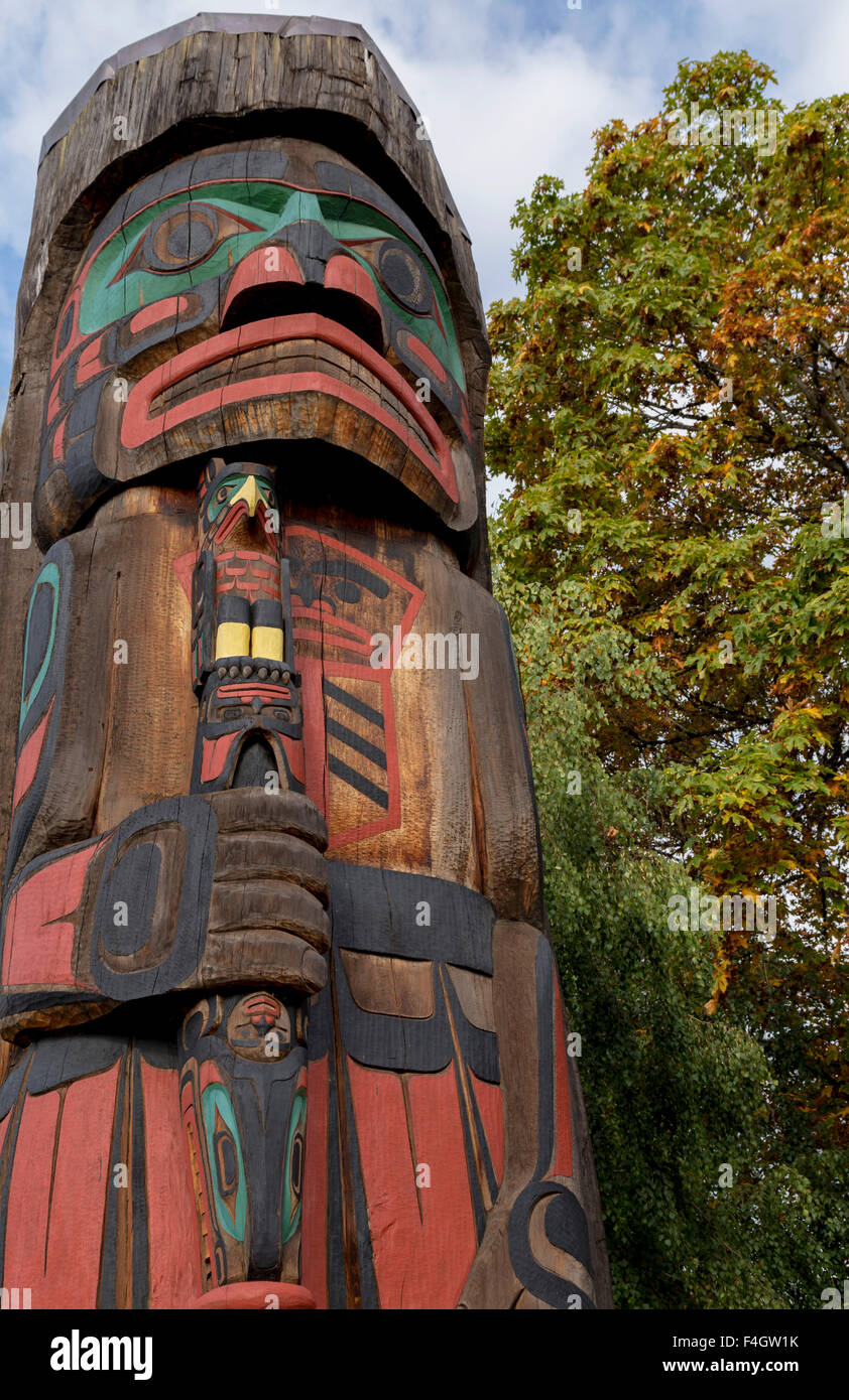 """Totem pole called """"Cedar Man Walking out of the Log'', in Duncan, Cowichan Valley, Vancouver Island, British Columbia, Stock Photo"""