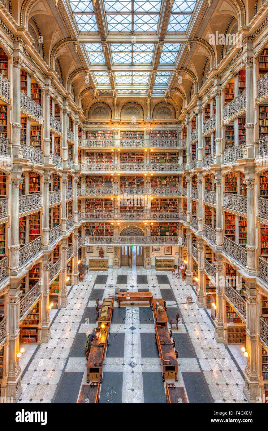 The beautiful interior of the George Peabody Library, a part of Johns Hopkins University, in Baltimore, Maryland. - Stock Image