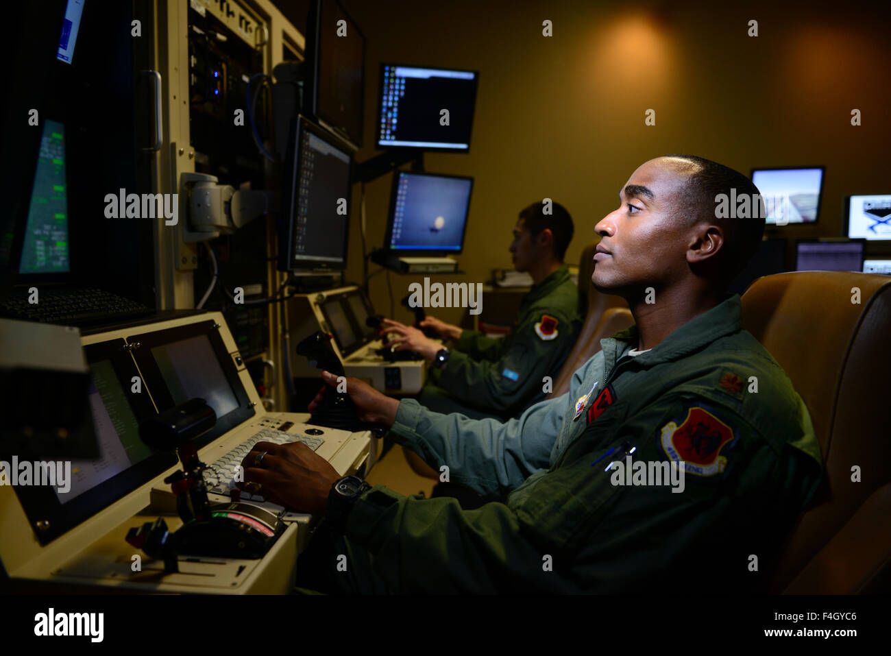 A U.S. Air Force MQ-9 Reaper UAV drone pilot controls an aircraft from the remote console at Creech Air Force Base - Stock Image