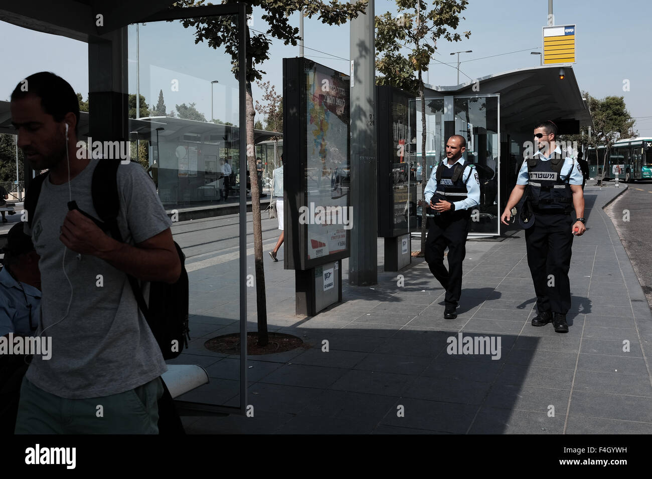 Policemen patrol the bus and tram station on Mount Herzl in Jerusalem following a wave of Palestinian stabbing attacks - Stock Image
