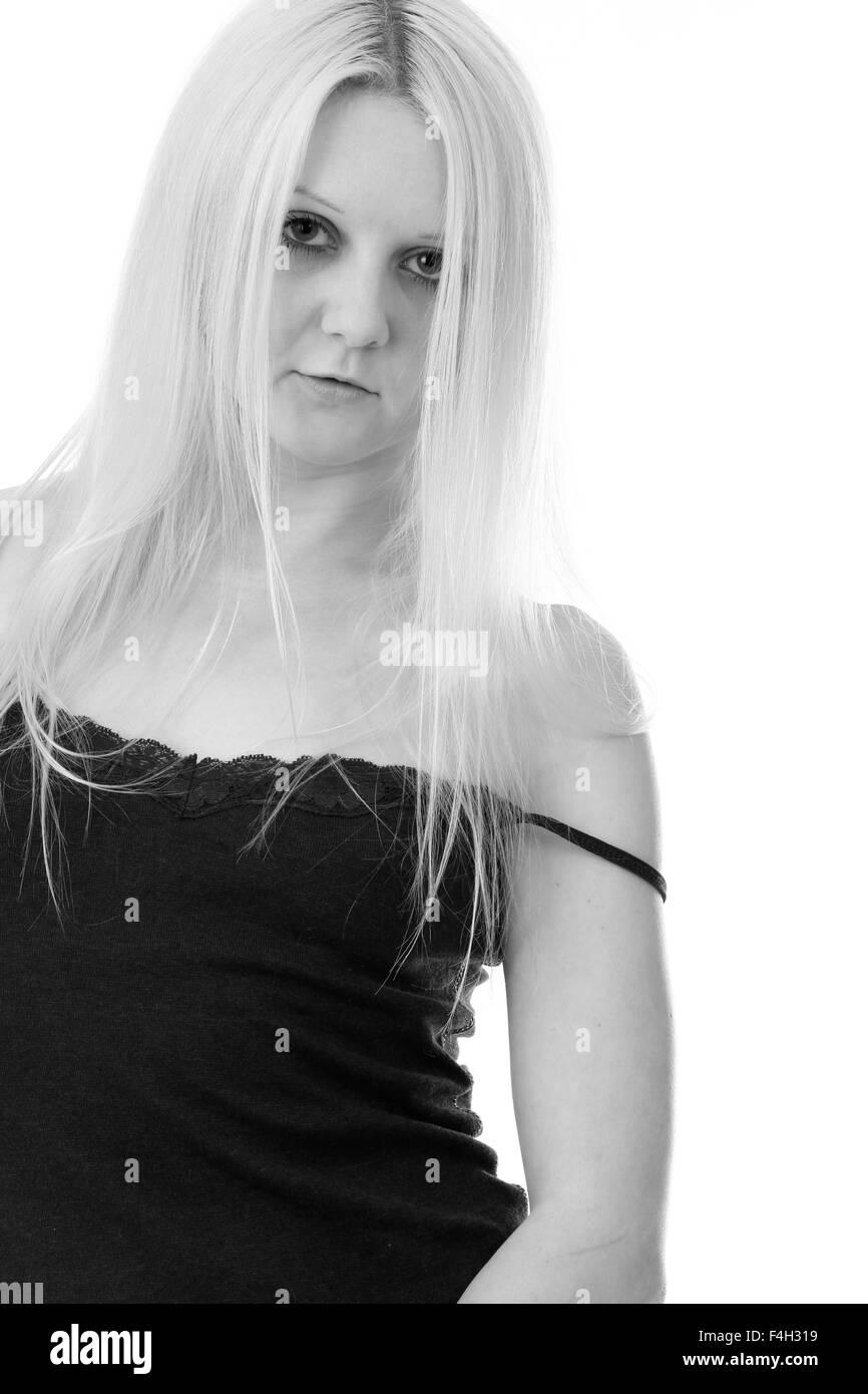 young blonde woman in her nightwear pyjamas. - Stock Image
