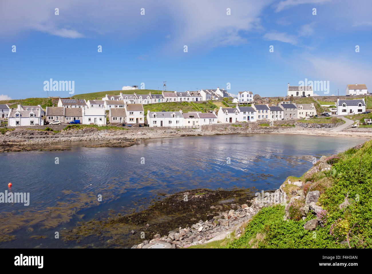 Traditional cottages around harbour in Islay village of Portnahaven, Isle of Islay, Argyll and Bute, Inner Hebrides, - Stock Image