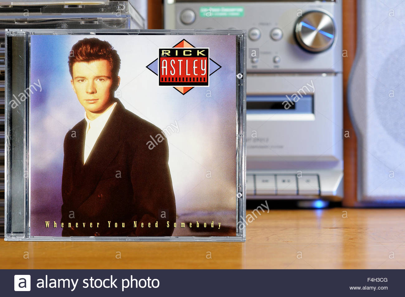 Rick Astley 1987 debut album 'Whenever You Need Somebody', piled music CD cases, England - Stock Image