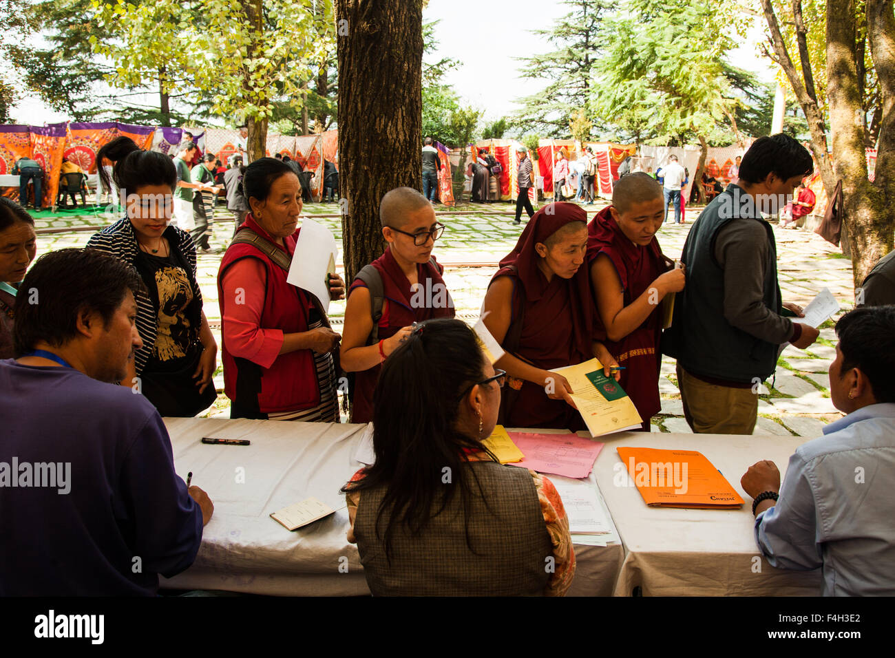 Mcleodganj, Himachal Pradesh. 18 october 2015. Exiled tibetans casting their vote in the preliminary round of parliamentary - Stock Image