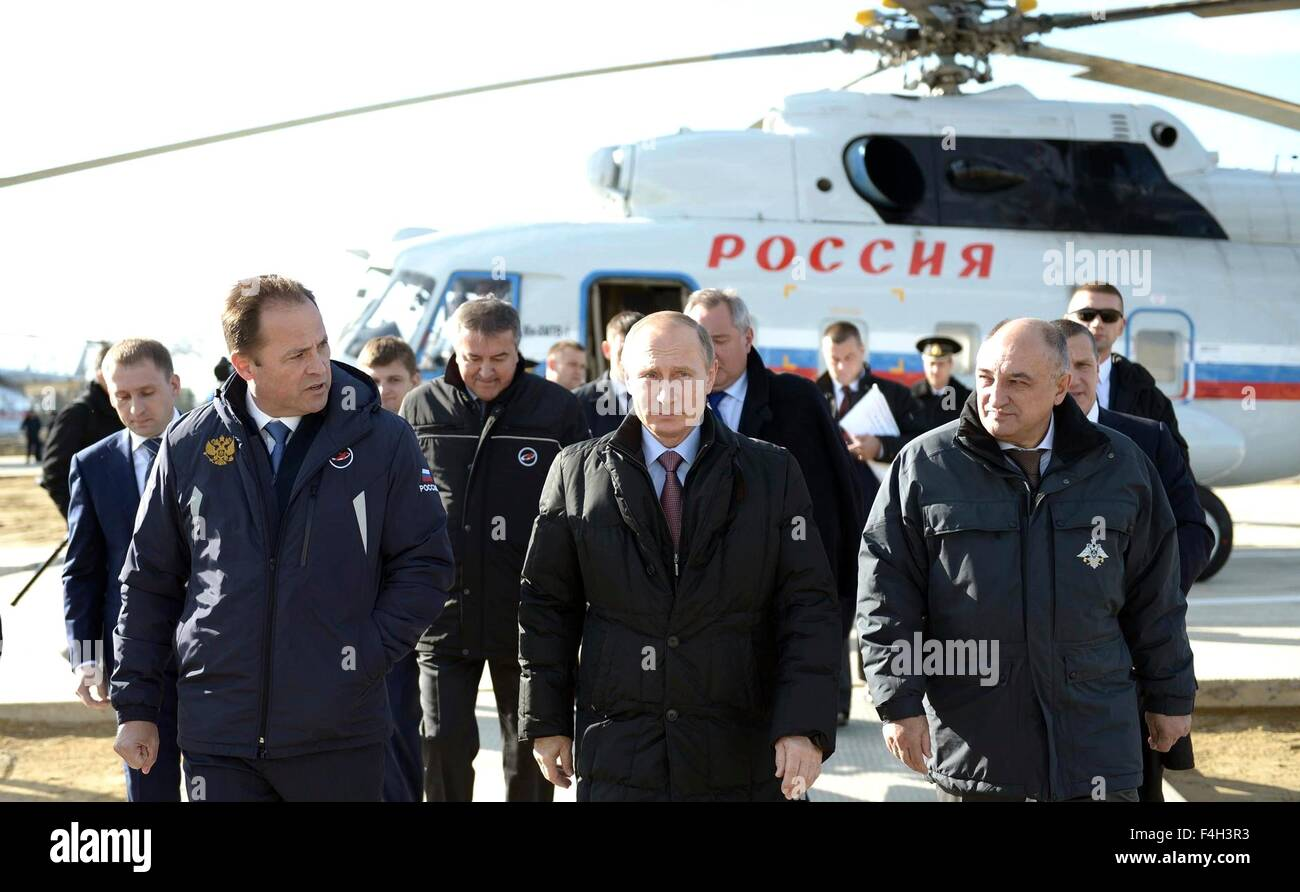 Russian President Vladimir Putin, escorted by the Russian Federal Space Agency head Igor Komarov, left, arrives - Stock Image