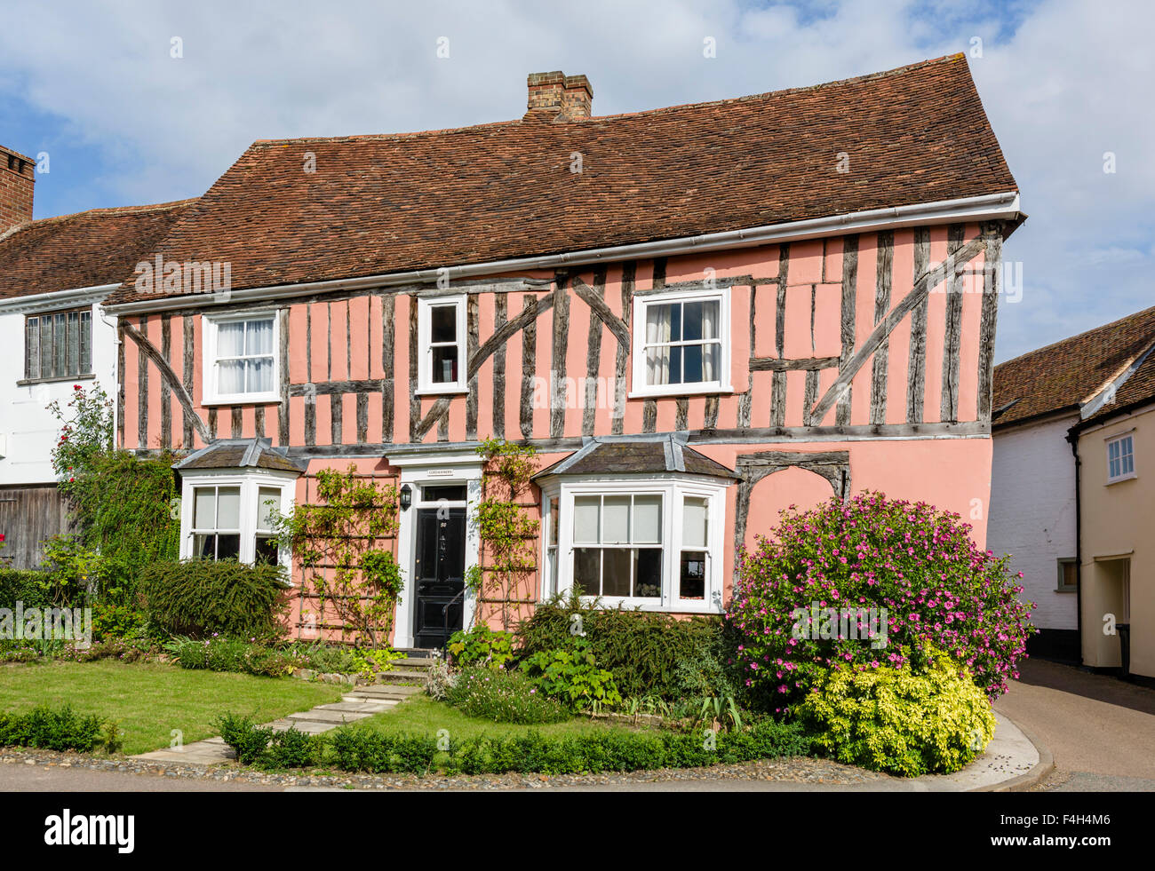 A colourful old crooked house in the village of Lavenham, Suffolk, England, UK - Stock Image