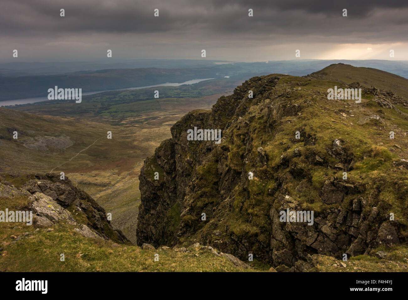 Looking down from Dow Crag towards Coniston Water on a moody autumnal afternoon - Stock Image