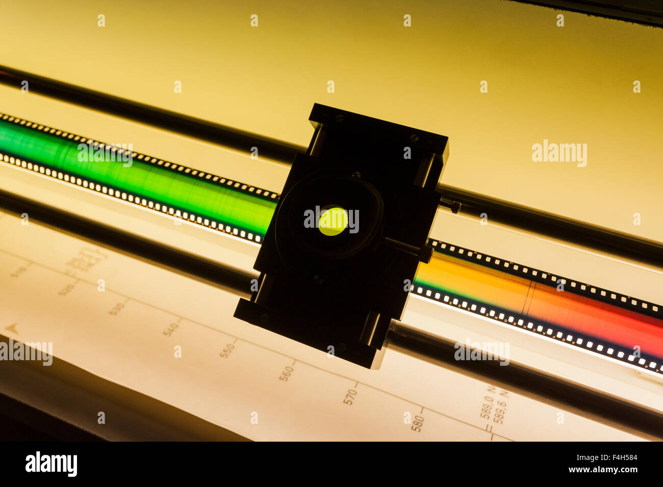 Strip of 35mm film with the full spectrum of visible solar light exposed onto it, at the Canarian astrophysics institute, - Stock Image