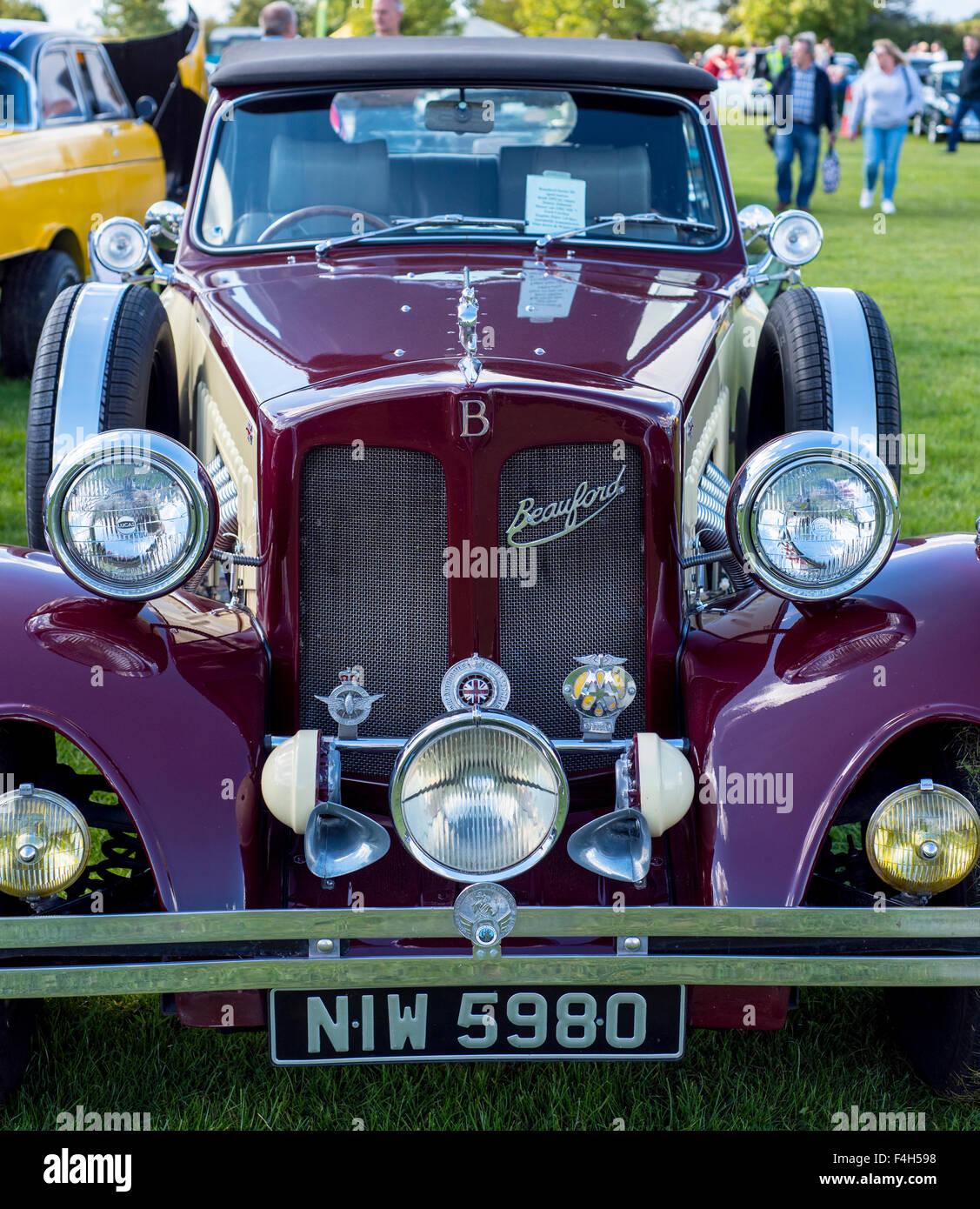 Beauford car, with emblem, headlamps, grille, bonnet, hood, windscreen, spare tires, bumper, purple, silver, badges, - Stock Image