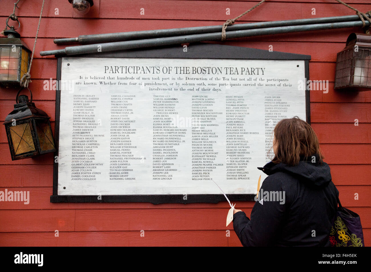 A tourist reading the list of names of the participants of the Boston Tea Party; the Boston Tea Party Ships & - Stock Image