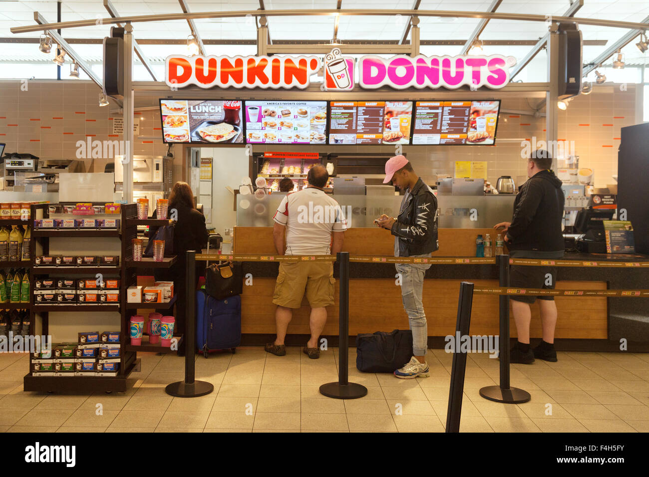 people in a queue at dunkin donuts fast food restaurant the stock photo 88888015 alamy. Black Bedroom Furniture Sets. Home Design Ideas